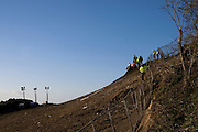 Security men on the slope of Rath Lugh, where the M3 Motorway cuts through it. Rath Lugh is an ancient bronze age promontory fort currently tagged for considerable damage destruction by the construction of the M3 motorway between Dublin and Navan. Protestors are camped in the woods, in oposition to the construction work. ....