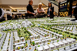 Model of new luxury housing development at Akoya Park a Trump property investment in Dubai United Arab Emirates
