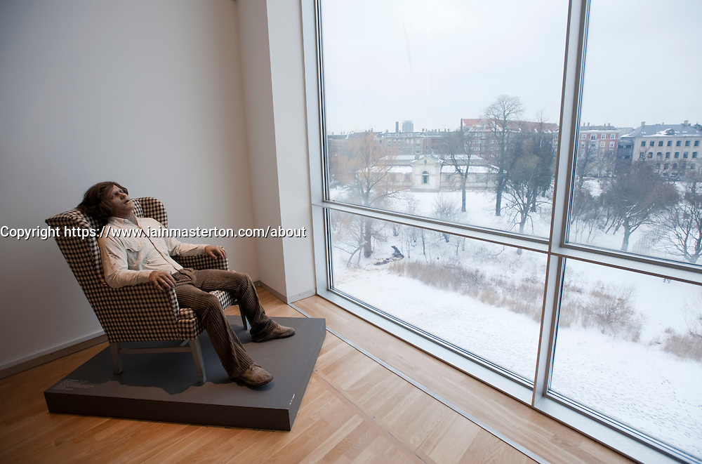A Sleeping Man in a Chair by Kurt Tramdedach at Statens Museum for Kunst or Royal Museum of Fine Arts in Copenhagen Denmark