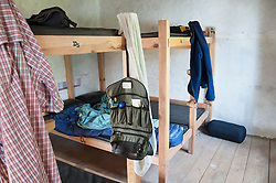 Wooden bunk beds cabin clothes hanging