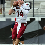 South Carolina Gamecocks quarterback Connor Shaw (14) warms up prior to an NCAA football game between the South Carolina Gamecocks and the Central Florida Knights at Bright House Networks Stadium on Saturday, September 28, 2013 in Orlando, Florida. (AP Photo/Alex Menendez)