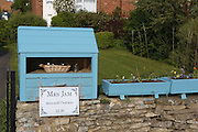 Jams are on sale in front of a house on the road towards Burythorpe, Yorkshire, England, United Kingdom.