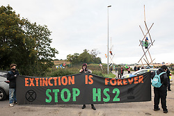 Anti-HS2 activists use a tripod to block one of several entrances blocked to the Chiltern Tunnel South Portal site for the HS2 high-speed rail link on 9 October 2020 in West Hyde, United Kingdom. The protest action, at the site from which HS2 Ltd intends to drill a 10-mile tunnel through the Chilterns, was intended to remind Prime Minister Boris Johnson that he committed to remove deforestation from supply chains and to provide legal protection for 30% of UK land for biodiversity by 2030 at the first UN Summit on Biodiversity on 30th September.