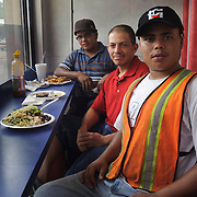 (left to right) Angel Banegas, Wilmer Danilo and Rony Diaz, all from Honduras pose for a photograph in their lunch break from their work which is at a Construction in Brentwood. (July. 14, 2012)