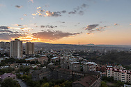 Cityscape view at sunrise from an apartment building balcony in Yerevan, Armenia