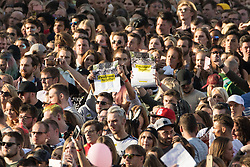 "© Licensed to London News Pictures . 04/06/2017 . Manchester , UK . People hold "" We stand together "" posters in the crowd . The One Love Manchester benefit concert for victims of the Manchester Arena terrorist attack , at the Emirates Old Trafford Cricket Stadium . Ariana Grande, Justin Bieber, Coldplay, Katy Perry, Miley Cyrus, Pharrell Williams, Usher, Take That, Robbie Williams, Black Eyed Peas and Niall Horan are amongst the performers. Photo credit : Joel Goodman/LNP"
