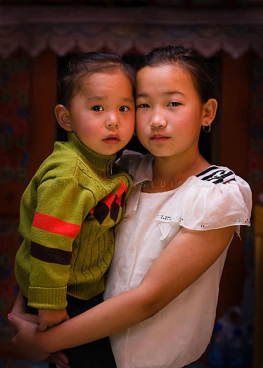Portrait of two sisters from a nomad family in a ger in the Gobi Desert, Mongolia. Photo © Robert van Sluis