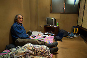 Day laborer Isamu Matsue in the cheap hotel room where he lives in Kamagasaki.