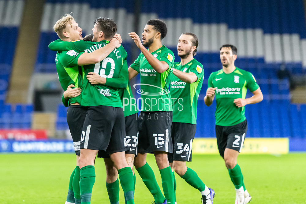 CELE Birmingham City's Marc Roberts (4) celebrates scoring the opening goal with his team mates during the EFL Sky Bet Championship match between Cardiff City and Birmingham City at the Cardiff City Stadium, Cardiff, Wales on 16 December 2020.