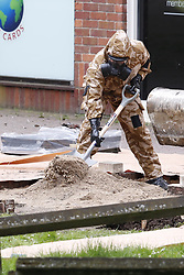 © Licensed to London News Pictures. 24/04/2018. Salisbury, UK. Members of the armed forces are seen at the Maltings shopping area as a cleanup operation begins in Salisbury. Former Russian Spy Sergei Skripal and his daughter Yulia were poisoned using a nerve agent in the city last month. Experts have warned that 'Toxic levels' of the nerve agent novichok could still be present at hot spots around the city. Photo credit: Peter Macdiarmid/LNP