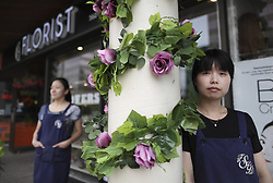 July 25, 2018 - Toronto, ON, Canada - TORONTO, ON - July 25    Summer Lin (right) and Katherine Liu run the Secret Garden Florist shop at Finch and Yonge street.  The van rampage began close to their shop and they were very involved in the memorial and supplying flowers to mourners..Talking to victims, witnesses and local businesses impacted by the van attack about advice they'd give to people on the Danforth for getting through the next few weeks.  .July 25, 2018 Richard Lautens/Toronto Star (Credit Image: © Richard Lautens/The Toronto Star via ZUMA Wire)