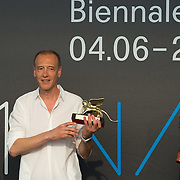 VENICE, ITALY - JUNE 04: Artist Christian Marclay is awarded the  Golden Lion for the Bes Artist at ILLUMInation Exhibition at the Official Awards  of the 54th International Art Exhibition on June 4, 2011 in Venice, Italy. This year's Biennale is the 54th edition and will run from June 4th until 27 November.