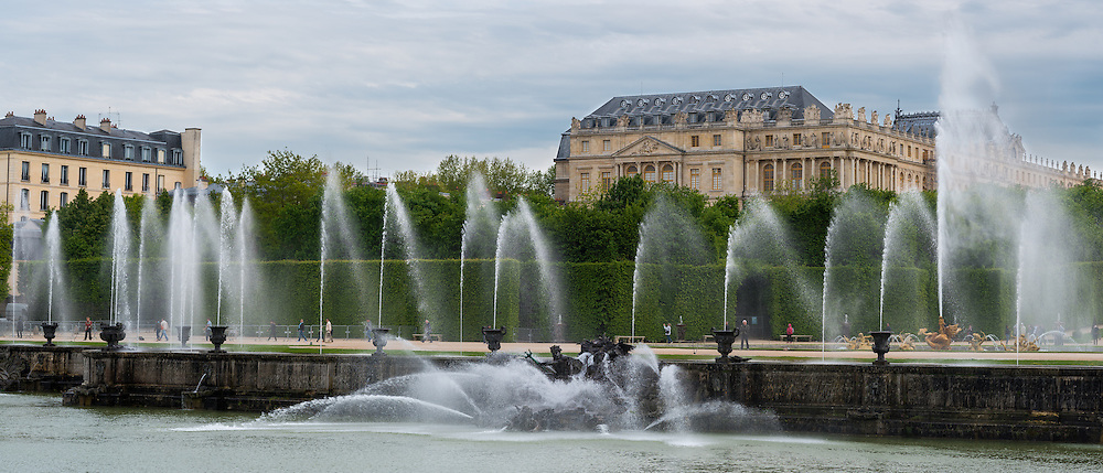 A panoramic photo of Grandes Eaux fountain display at the Château de Versailles, which only goes off on weekends and special holidays.