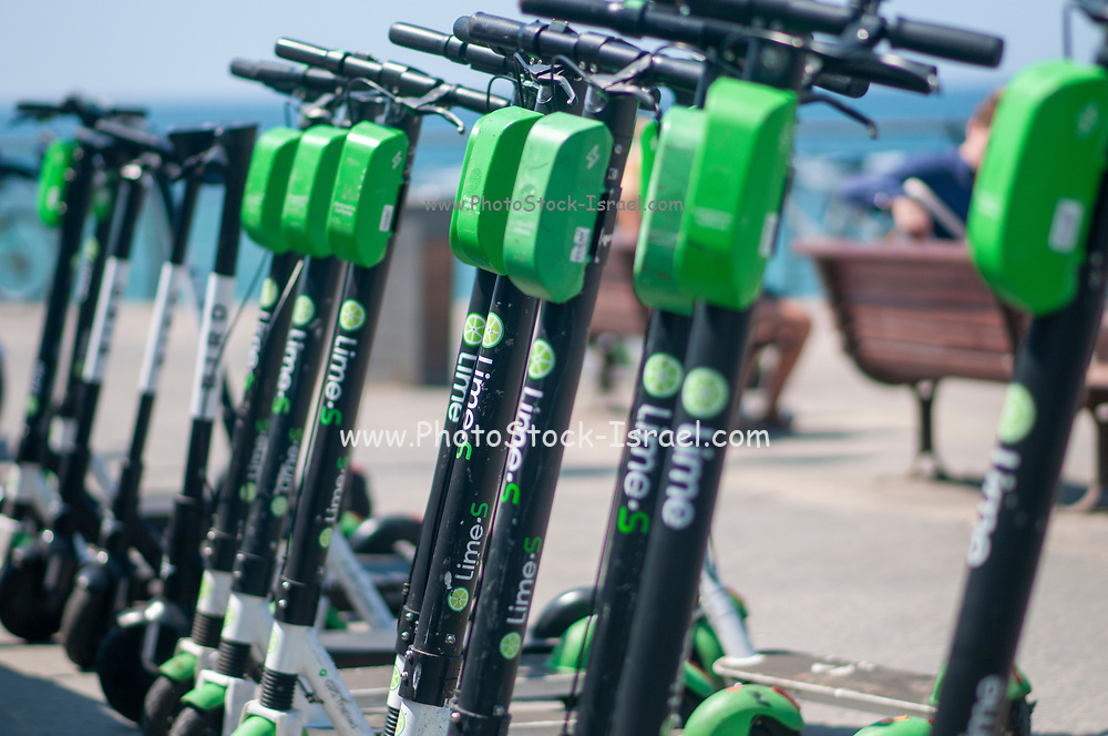Lime and Bird electric scooters for rent by the minute Photographed in Tel Aviv, Israel where these machines are a major threat and disturbance to pedestrians