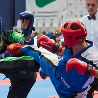 Damias Konstantinos (in red) of Greece and Dusard Nicholos (in blue) of Jamaica fight in the men's -69 kg preliminary during the WAKO World Kick-boxing Championships in Budapest, Hungary on Nov. 6, 2017. ATTILA VOLGYI