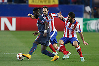 Atletico de Madrid´s Arda Turan (R) and Olympiacos´s Masauku during Champions League soccer match between Atletico de Madrid and Olympiacos at Vicente Calderon stadium in Madrid, Spain. November 26, 2014. (ALTERPHOTOS/Victor Blanco)
