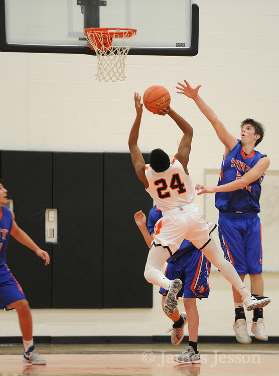 Newton North senior Kyle Ray-Canada brings the ball to the basket during the game against Newton South at Newton North, Dec. 27, 2018.   [Wicked Local Photo/James Jesson]