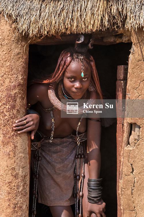 Himba girl in the village, Damaraland, Kuene Region, Namibia