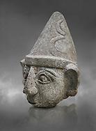 Hittite statue head of a god, Hittite capital Hattusa, Hittite Middle Kingdom 1650-1450 BC, Bogazkale archaeological Museum, Turkey. Grey background
