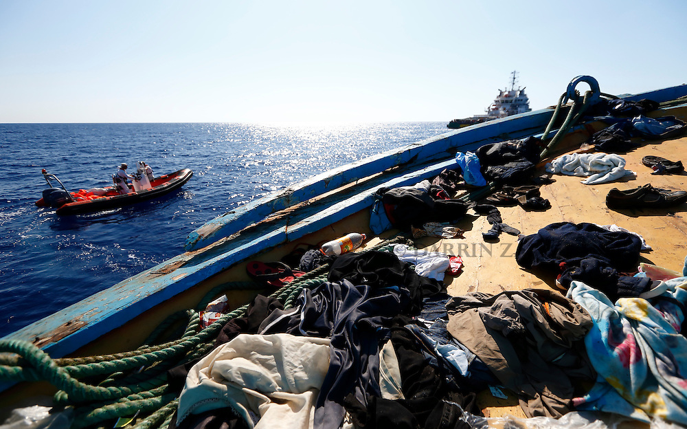 Migrants' belongings litter the deck of a wooden boat from which migrants were rescued 10.5 miles (16 kilometres) off the coast of Libya August 6, 2015.  An estimated 600 migrants on the boat were rescued by the international non-governmental organisations Medecins san Frontiere (MSF) and the Migrant Offshore Aid Station (MOAS) without loss of life on Thursday afternoon, according to MSF and MOAS, a day after more than 200 migrants are feared to have drowned in the latest Mediterranean boat tragedy after rescuers saved over 370 people from a capsized boat thought to be carrying 600.<br /> REUTERS/Darrin Zammit Lupi <br /> MALTA OUT. NO COMMERCIAL OR EDITORIAL SALES IN MALTA
