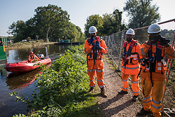 HS2 security guards monitor and film a press photographer on a public footpath during tree felling works alongside the Grand Union Canal in connection with the HS2 high-speed rail link on 21 September 2020 in Harefield, United Kingdom. Thousands of trees have already been felled in the Colne Valley for the controversial £106bn rail link.