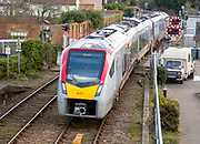 British Rail Class 755 Stadler bi-modal train arriving at railway station, Woodbridge, Suffolk, England, UK