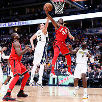 01 November 2017: Toronto Raptors forward Norman Powell (24) goes for the layup past Denver Nuggets center Nikola Jokic (15) and Denver Nuggets forward Paul Millsap (4) during the Denver Nuggets 129-111 victory over the Toronto Raptors, at the Pepsi Center, Denver, Colorado, USA.