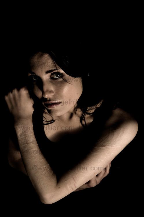 woman showing self harm scars