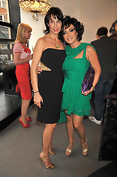 Left to right, ASSIA WEBSTER and NANCY DELL'OLIO at a party to celebrate the new Stephen Webster store on Mount Street, London W1 followed by a dinner at Maddox, Mill Street, London on 24th June 2009.