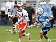 Virginia Cavaliers (3) is defended by Johns Hopkins (34) during the game in Charlottesville, VA. Johns Hopkins defeated Virginia 11-10 in overtime. Photo/Andrew Shurtleff