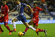 Wigan midfielder Michael Jacobs attacks during the Sky Bet League 1 match between Wigan Athletic and Gillingham at the DW Stadium, Wigan, England on 7 January 2016. Photo by Pete Burns.