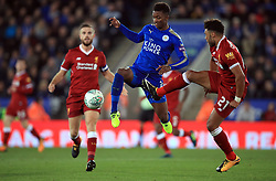 Leicester City's Demarai Gray and Liverpool's Alex Oxlade-Chamberlain (right) battle for the ball during the Carabao Cup, third round match at the King Power Stadium, Leicester.