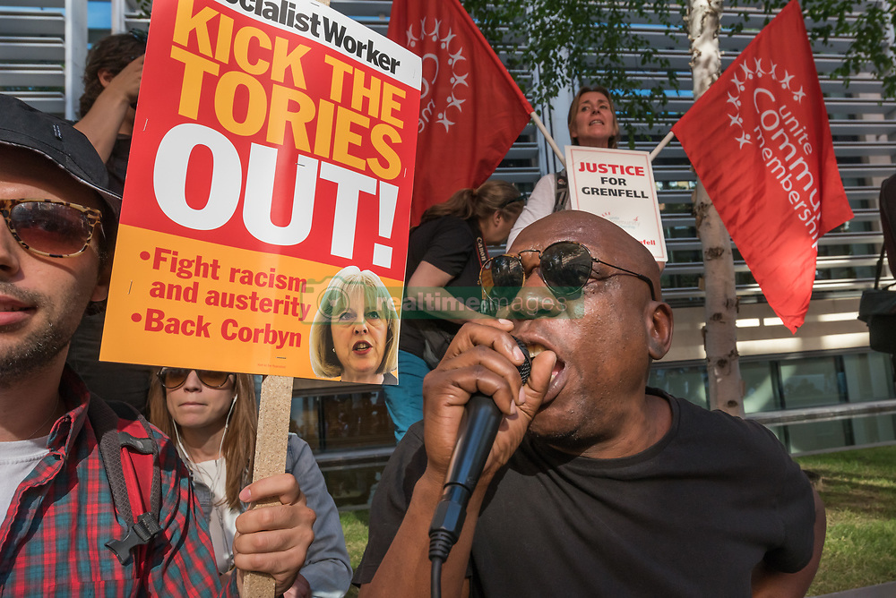 June 16, 2017 - London, UK - London, UK. 16th June 2017. Around a thousand protesters met outside the Department for Communities and Local Government calling for urgent action to identify those responsible for the unsafe state of Grenfell Tower which led to the horrific fire in which over 150 people were burnt to death. Speakers included Matt Wrack, Fire Brigades Union General Secretary, local residents who had witnessed the deaths, housing activists who have long called for social housing to meet the same safety standards as private developments and Stand Up to Racism, and there was a silence in solidarity with the dead and injured. After the rally they marched to Downing St, demanding the resignation of Theresa May and former housing minister Gavin Barwell who failed to implement the recommendations made after a previous London fire disaster. Peter Marshall ImagesLive (Credit Image: © Peter Marshall/ImagesLive via ZUMA Wire)