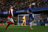 Aaron Ramsey chases down Gary Cahill of Chelsea ® who is controlling the ball . Premier league match, Chelsea v Arsenal at Stamford Bridge in London on Sunday 17th September 2017.<br /> pic by Kieran Clarke, Andrew Orchard sports photography.