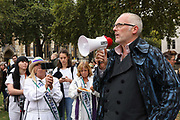 Joe Corre of Talk Fracking speak in support of the Lancashire women and the anti-fraacking movement.  UP to a hundred women from the Lancashire anti-fracking movement dressed as suffragettes congregate in Parliament Square and pay the Dep For Energy, Business and Industrial Strategy a visit, London, Unted Kingdom, September 12 2018