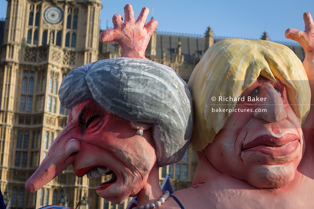 As Prime Minister Theresa May tours European capitals hoping to persuade foreign leaders to accept a new Brexit deal (following her cancellation of a Parliamentary vote), pro-EU Remainers protest with satirical figure of Theresa May and Boris Johnson opposite the Houses of Parliament, on 11th December 2018, in London, England.