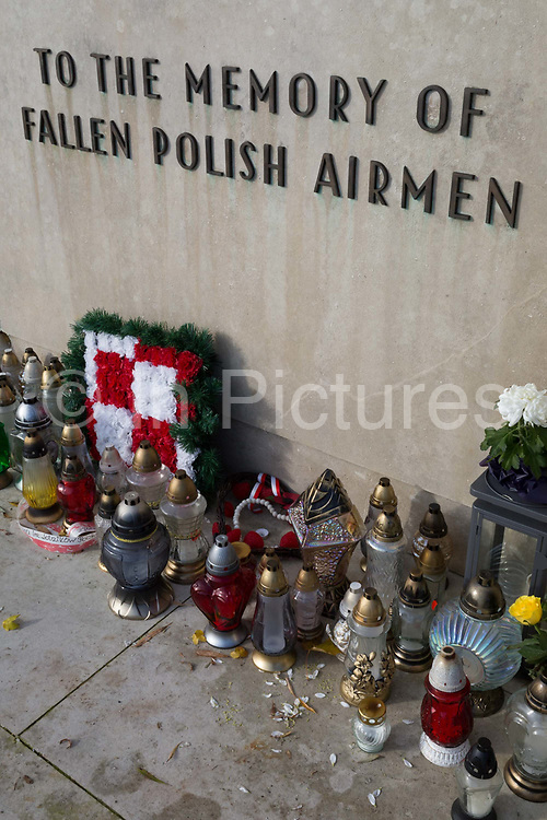 In memory of fallen WW2 Polish Air Force crews, are the front gates of Polish War Memorial, on 6th November 2019, in South Ruislip, Northolt, London, England. The Polish War Memorial is in memory of airmen from Poland who served in the Royal Air Force as part of the Polish contribution to World War II. The memorial was designed by Mieczyslaw Lubelski, who had been interned in a forced labour camp during the war. It is constructed from Portland stone with bronze lettering and a bronze eagle, the symbol of the Polish Air Force. The original intention was to record the names of all those Polish airmen who lost their lives while serving during WW2 a total of 2,408 but there was not enough space for this and, as a compromise, the names of the 1,241 who died in operational sorties are there instead.