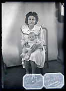studio portrait of mother holding a baby France circa 1930s