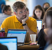 Teachers participate in PowerUp HUB training at Chavez High School, August 20, 2014.
