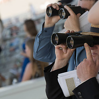 Viewers wearing various hats watch Hungarian horse race derby in Budapest, Hungary on July 4, 2021. ATTILA VOLGYI