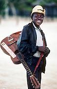 12 FEBRUARY 1986, OCHO RIOS, JAMAICA: Boy with guitar on the beach in Ocho Rios, Jamaica, Feb. 1987..PHOTO BY JACK KURTZ