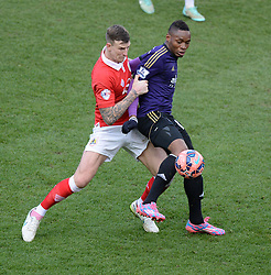 West Ham's Diafra Sakho battles for the ball with Bristol City's Aden Flint- Photo mandatory by-line: Alex James/JMP - Mobile: 07966 386802 - 25/01/2015 - SPORT - Football - Bristol - Ashton Gate - Bristol City v West Ham United - FA Cup Fourth Round
