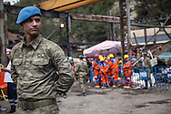 A Turkish Jandarma guards the rescue team at the Soma coal mine site in western Turkey, on day three of the rescue attempt.