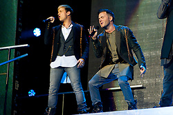 © Licensed to London News Pictures. 23/05/2012. London, UK. Westlife perform live at The O2 Arena, London, as part of their final ever farewell tour.   Westlife are an Irish boy band formed in 1998. They are to disband in 2012 after their farewell tour. The group's line-up was Shane Filan, Mark Feehily, Nicky Byrne, and Kian Egan.  In this picture L to R - Kian Egan, Shane Filan.  Westlife have sold over 45 million records worldwide which includes studio albums, singles, video release, and compilation albums.  Photo credit : Richard Isaac/LNP