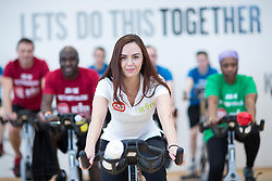"© Licensed to London News Pictures . 01/03/2016 . Manchester , UK . Hollyoaks actress JENNIFER METCALFE (front) launches a national fundraiser , "" The Better Bike Challenge "" from the East Manchester Leisure Centre in Beswick . The Challenge features 10,000 people cycling one-mile , each donating £1 to #TeamBetter for Sport Relief . Photo credit : Joel Goodman/LNP"