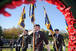 Royal British Legion standard bearers march past a wreath of poppies in the Royal Wootton Bassett Field of Remembrance at Lydiard park, Swindon, as it opens to honour and remember those who have been lost serving in the Armed Forces.