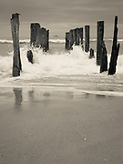 View of the abandoned pier on St. Clair Beach, with White Island in the distance; Dunedin, Otago, New Zealand