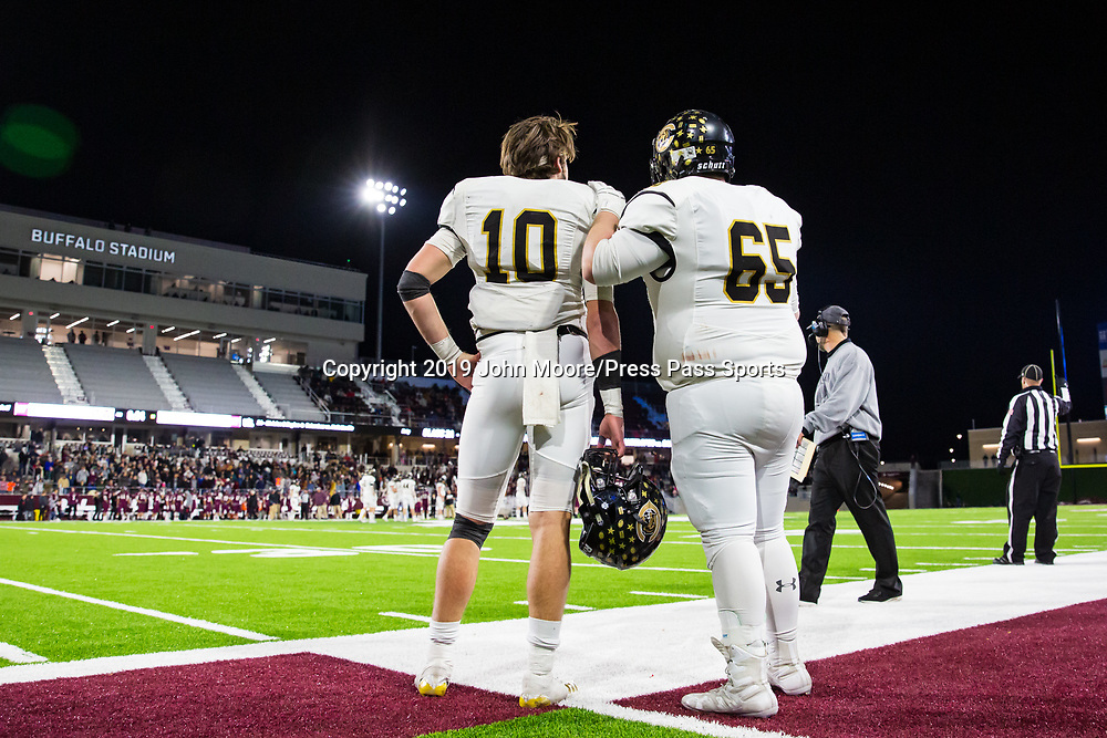 Canadian's Grant McCook (10) and Cody Cooke (65) talk on the sideline during the game against Abernathy in the UIL 3A-D2 Region 1 Championship on Friday, Dec. 6, 2019, at Buffalo Stadium in Canyon, Texas. [Photo by John Moore/Press Pass Sports]