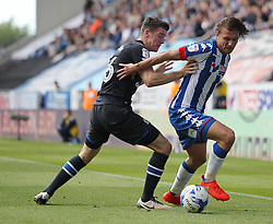 Darragh Lenihan of Blackburn Rovers (L) and Alex Gilbey of Wigan Athletic in action - Mandatory by-line: Jack Phillips/JMP - 13/08/2016 - FOOTBALL - DW Stadium - Wigan, England - Wigan Athletic v Blackburn Rovers - EFL Sky Bet Championship