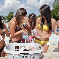 Participants look for swimsuites during the Miss Bikini Hungary beauty contest held in Budapest, Hungary on August 29, 2010. ATTILA VOLGYI